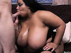Mega-tits ebony in fishnets is doggy-fucked